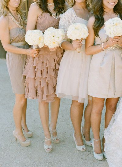blush colored Bridesmaids and white bouquets