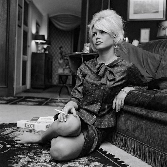 Brigitte Bardot with a carton of Kool Cigarettes at her home in 1962 .