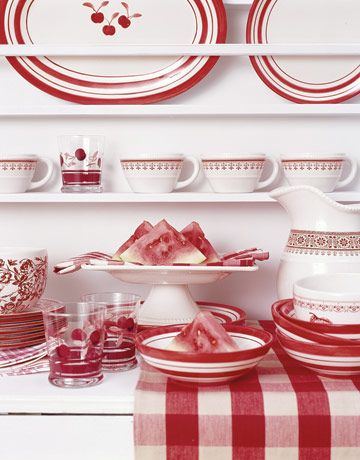 red and white dishes on display