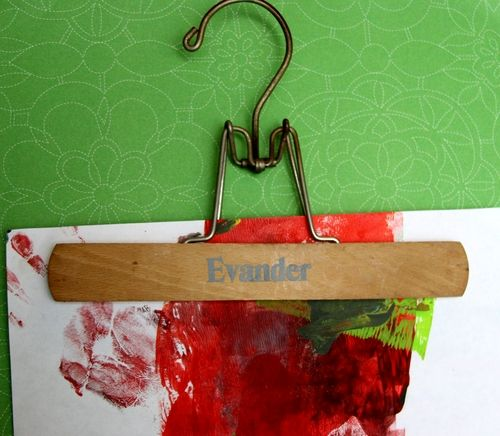Vintage hangers make an interesting display device, whether they're labeled or not. You can hang up prints you find at the flea market, old book pages, or whatever you want to display, and switching art takes about ten seconds.