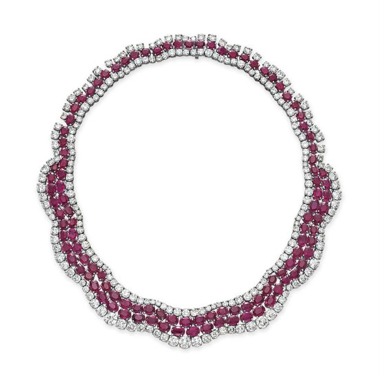 A RUBY AND DIAMOND NECKLACE  Designed as an undulating band of oval and pear-shaped rubies with circular-cut diamond trim, mounted in platinum, 16 ins.