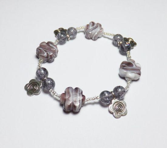 Purple Striped Flower Glass Stretch Bracelet with Pewter Flower Charms, by Designs by Tamiza, tzteja on Etsy, $10.00  #jewelry, #bracelet, #beaded, #designsbytamiza, #handmade, #ooak, #glass, #flower, #stripe, #pewter, #charmbracelet