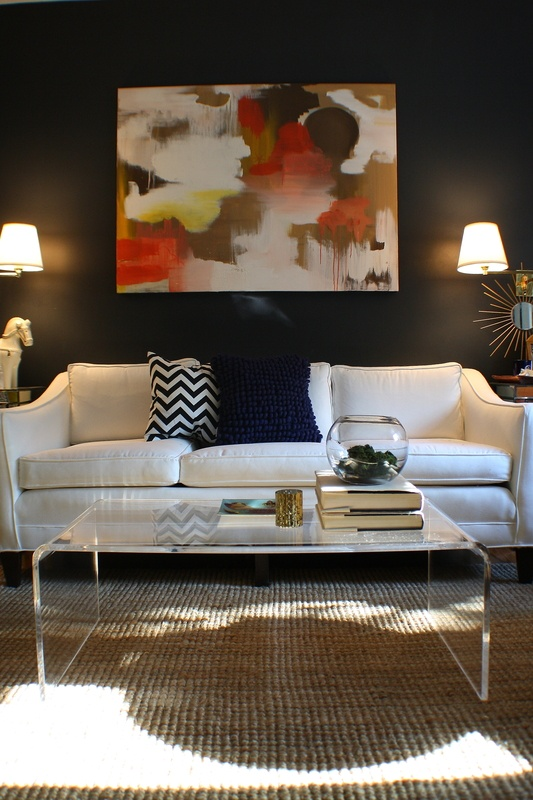 Modern mix.  Dark walls, lucite, abstract