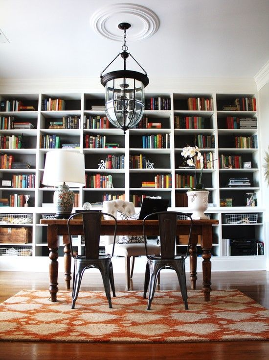 love the bookshelves, chairs, and rug