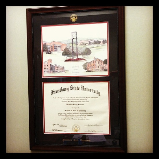 Celebrating history and heritage ... an alum proudly displays her diploma in her office.