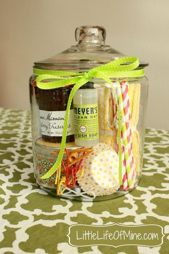 DIY Gift Basket Contents:      Strawberry jam     Cupcake liners     Dish towels     Striped paper straws     Scented candle     Mrs. Meyers dish soap     Bag clips     Glass jar (of course)