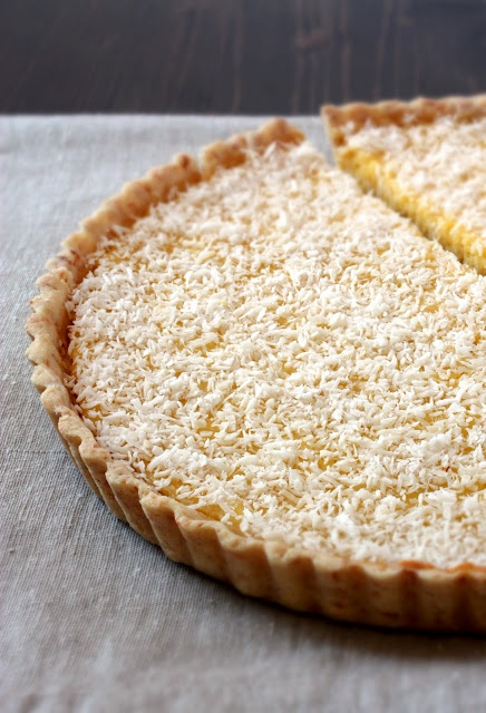 Love the combination of zingy and tropically sweet tastes at work in this refreshingly yummy Lemon Coconut Tart. #food #lemon #coconut #tart #pie #fruit #yellow #dessert
