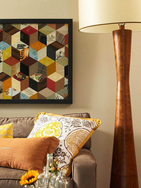 DIY wall art done with scrap or scrapbook papers cut into diamond shapes and fitted together.