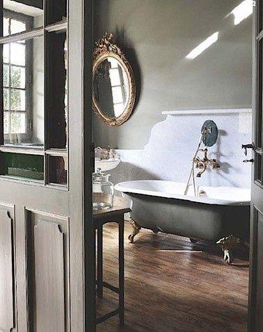 Claw foot tub, antique mirror