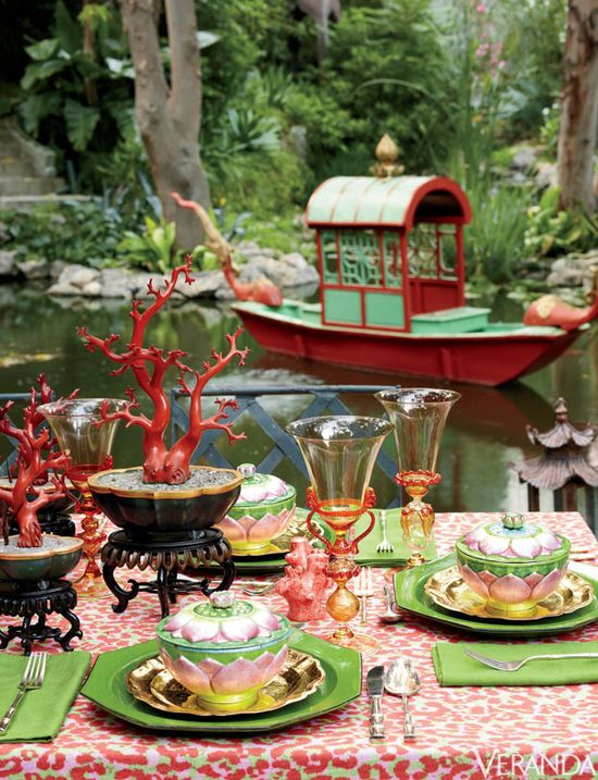 Linen for tablecloth, Jim Thompson's Tony Duquette Collection. Custom Venetian glasses. Black lacquer bowls and lotus bowls, all Chinese antiques. Vintage green chargers. Vietnamese wedding boat.