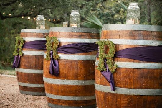 Wine barrels with moss monograms.