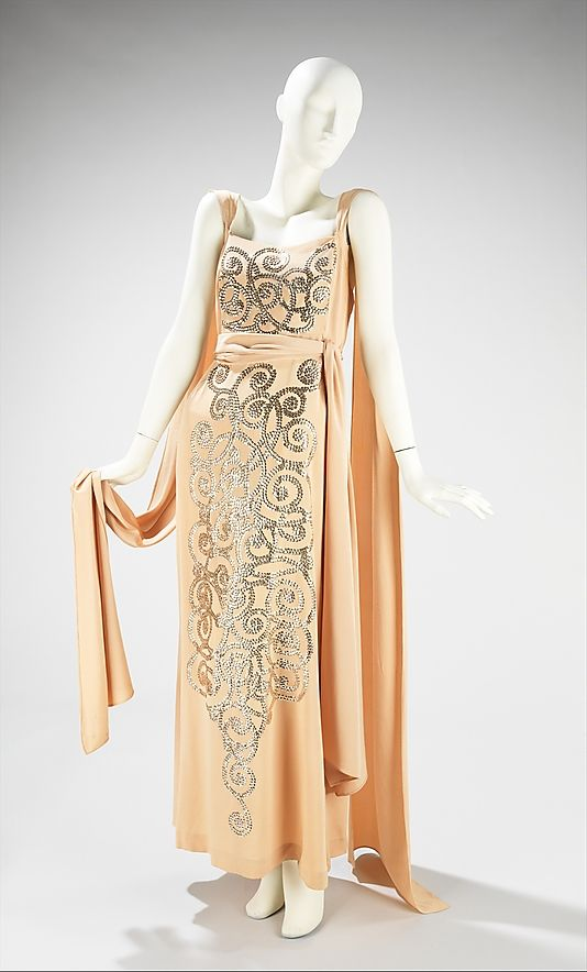 Dress, Evening  House of Lanvin  (French, founded 1889)    Designer:      Jeanne Lanvin (French, 1867–1946)  Date:      spring/summer 1937  Culture:      French  Medium:      synthetic  Dimensions:      Length at CB (a): 58 in. (147.3 cm) Length at CB (b): 99 in. (251.5 cm)  Credit Line:      Brooklyn Museum Costume Collection at The Metropolitan Museum of Art, Gift of the Brooklyn Museum, 2009; Gift of Mrs. Frederick H. Prince, Jr., 1967  Accession Number:      2009.300.3310a, b