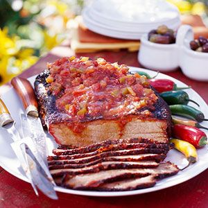 Hungry for barbecue? Try beef brisket that's seasoned with a dry rub, smoked for hours, and served with a beer sauce.