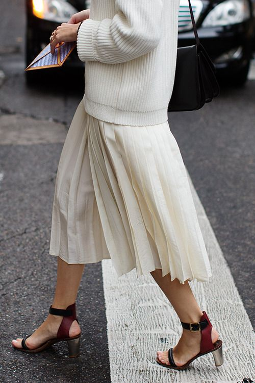 Sweater and pleats.
