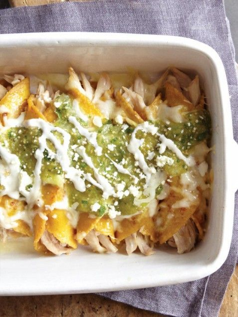 29 Easy Rotisserie Chicken Recipe Ideas, like this Chicken and Cheese Enchiladas with Salsa Verde. This will make weeknight planning a breeze! #letsfixdinner
