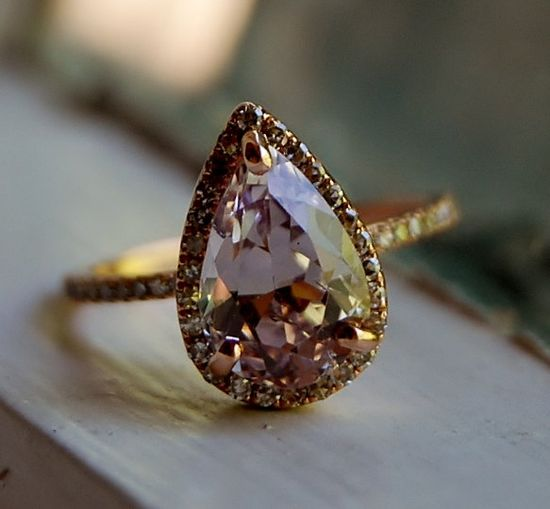 3ct Color change sapphire Lavender Peach champagne tear drop sapphire and rose gold diamond engagement ring. I like unique pretty rings.