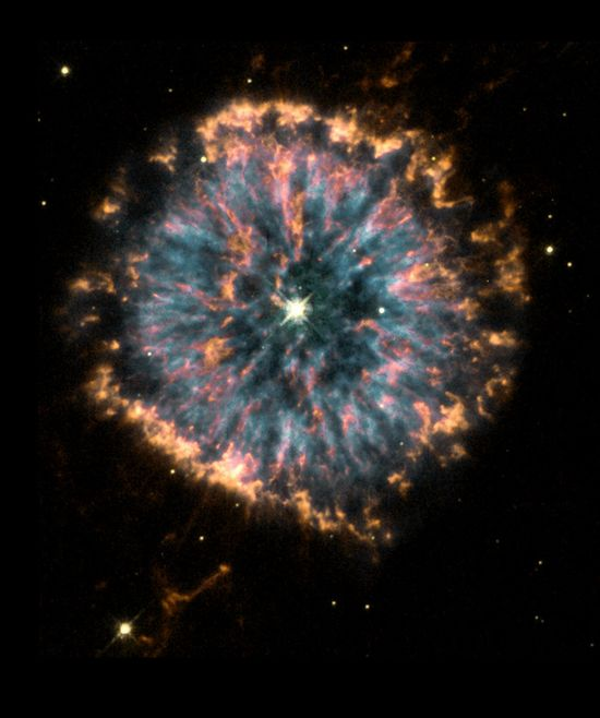 The Glowing Eye Credit: HST/NASA/ESAThe glowing eye of NGC 6751 in the constellation Aquila, the nebula is a cloud of gas ejected several thousand years ago from the hot star visible in its center.