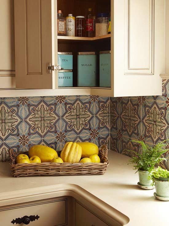 Colorful Kitchen Backsplash  Let a backsplash set the color palette for your kitchen. An antique blue-green-and-brown tile backsplash is the source of the color scheme for this hospitable kitchen. Cream-colore cabinets and cupboards frame the vintage design, allowing the backsplash to make a statement.