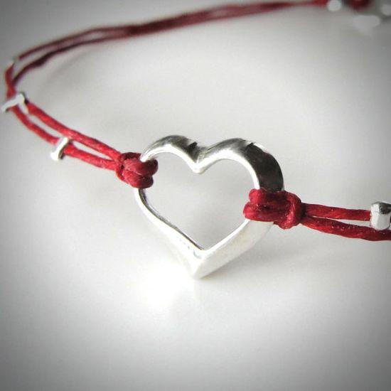 Sterling Floating Heart bracelet on linen from JewelryByMaeBee on Etsy.