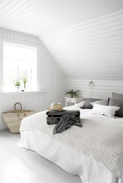 white and grey beach house bedroom