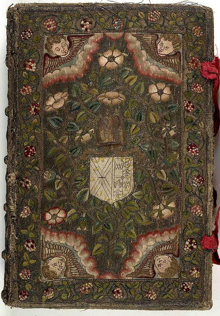 17th century embroidered Canvas book, pictorial angel and floral motif  with two red ribbons.    The Booke of Common Prayer (London, 1611) Collection: The British Library
