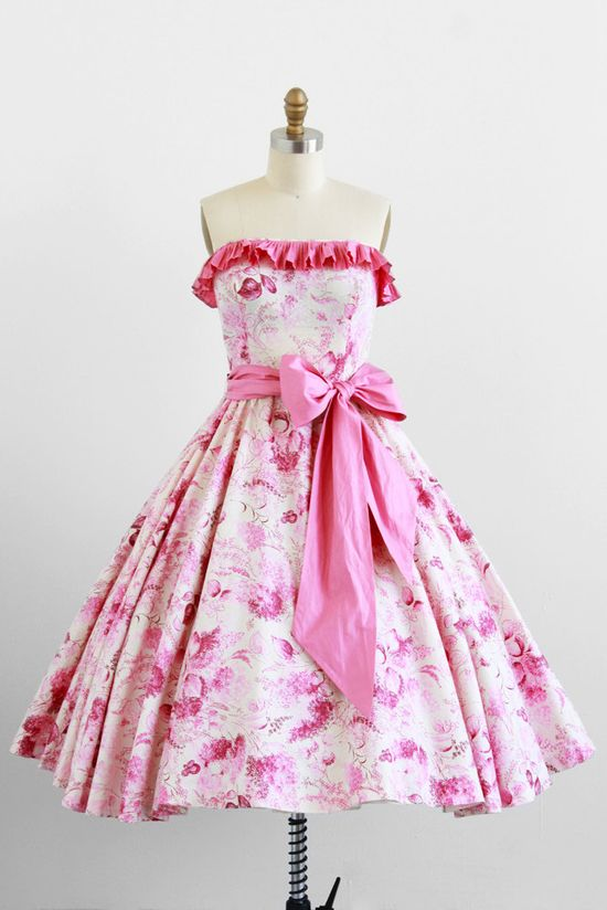 A terrifically pretty 1950s pink and white ruffled summer/party dress with a big pink bow sash. #fashion #floral #dress #1950s #partydress #vintage #frock #retro #sundress #floralprint #petticoat #romantic #feminine