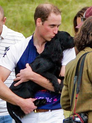 SO CUTE! William plants a kiss on pooch pal Lupo. Find out where he brought the royal pup: www.people.com/...