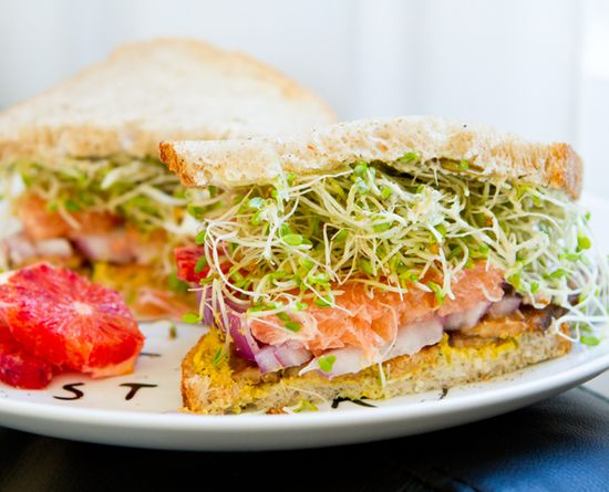 Sprout Lovers' Citrus Sandwich by thechalkboardmag: Sweet, peeled rounds of citrus add a vibrant, zesty-sweet flavor to sandwiches. They also add a nice amount of fiber and vitamin C to each bite. Use your citrus slice just as you would a tomato slice and layer it in a tall stack. Try oranges, satsumas, tangerines, pink grapefruit, blood orange and white grapefruit. #Sandwich #Citrus #Sprouts