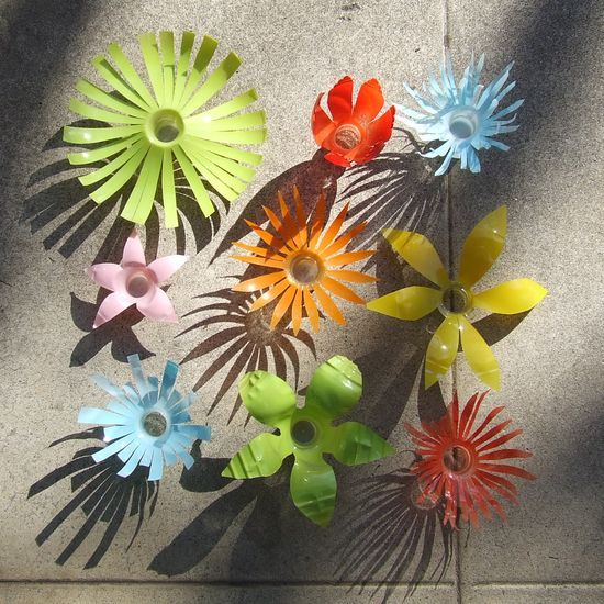 EArth Day water bottle flowers 2.  string them together to make a garland. these are spray painted. acrylics would work too?