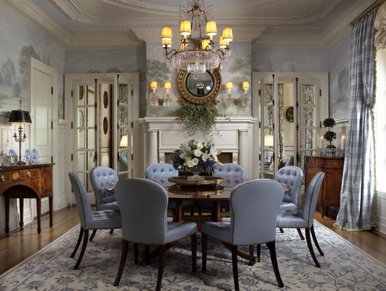 I like the mirrored French doors and the French sorcerer's round mirror above the mantel.     via   Scott Snyder, Inc.