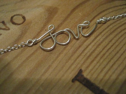 sterling silver love necklace.