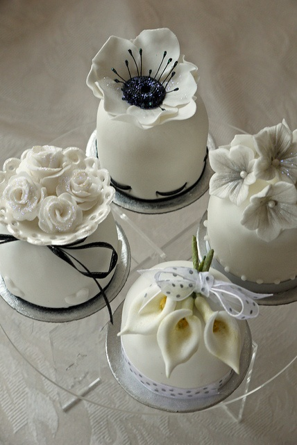 Quartet of miniature cakes in a black, white and grey