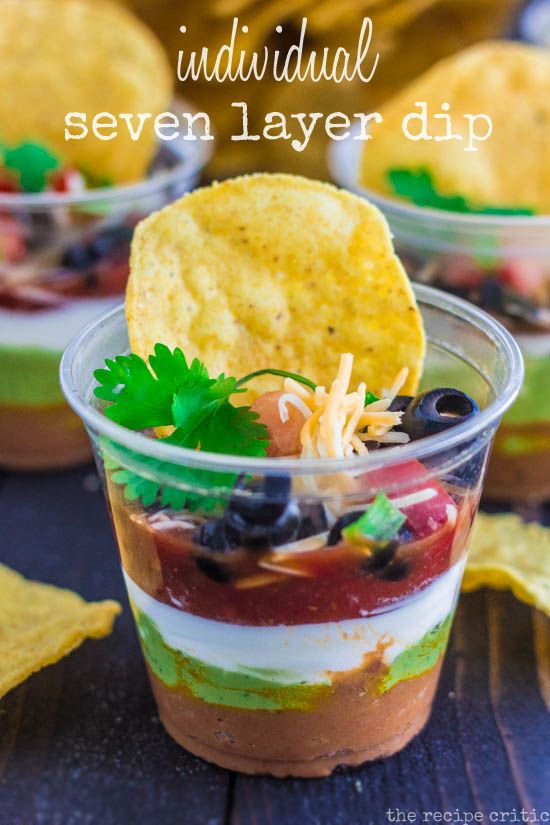 Individual Seven Layer Dip at therecipecritic.com  Delicious seven layer dip in individual servings!  Perfect for game day!!
