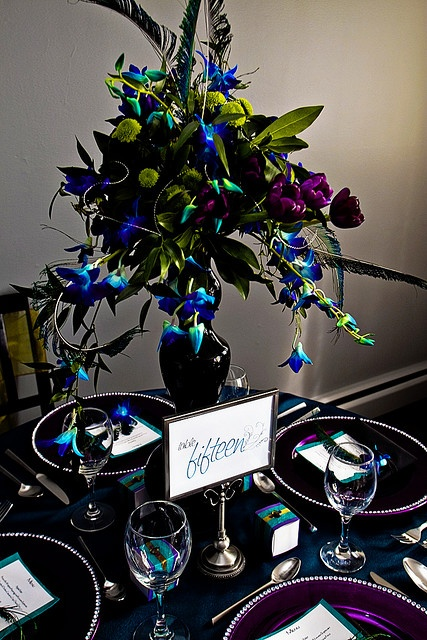 Peacock-themed wedding table setting.