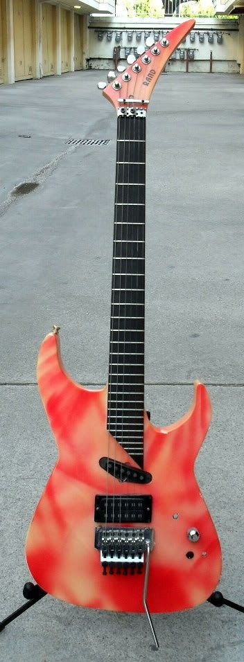 "On the ""Still of the Night"" video, former Whitesnake guitarist Vivian Campbell played this pink-red-and-yellow Rand, a high-end 27-fret guitar handmade by Rand Havener, a former B.C. Rich"