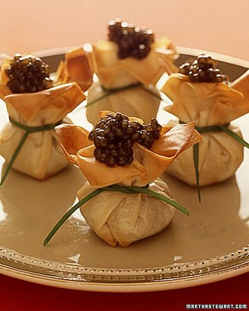 Phyllo purses topped with caviar. Get the recipe: www.marthastewart...