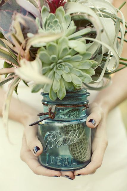 Succulent arrangement in vintage Ball jar for shower