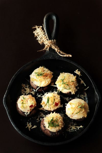 Savory Cheesy Stuffed Mushrooms... Stuffed Baby Bella mushrooms filled with goat cheese, cream cheese and roasted red peppers then topped with Panko and Parmesan cheese.