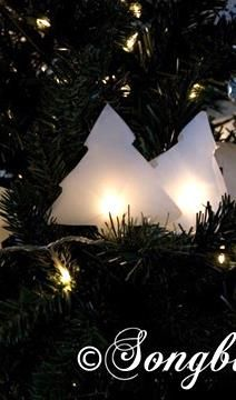 Decorate your Christmas tree with a special tree lights garland. Make little paper covers for the lights and add a personal touch to your Xmas tree with this easy craft. See more details at http:// www.songbirdblog.com