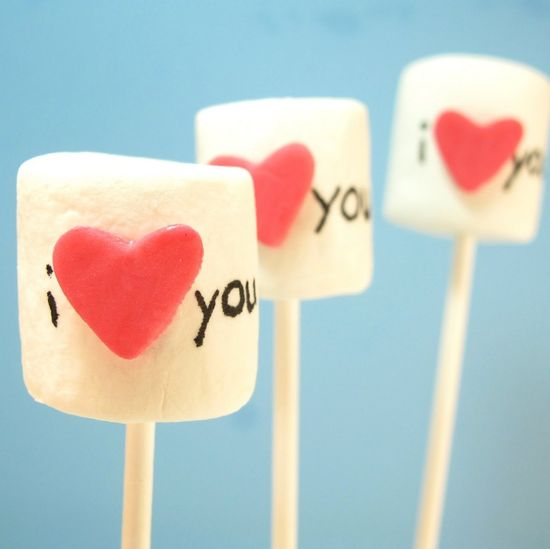 Valentine's Day Marshmallow Pops: Here's a little something sweet mama can whip up in just a few minutes. Food pens and marshmallows on sticks can help mama create a unique Valentine's Day treat!  Source: The Decorated Cookie Blog