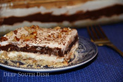 A decadent and well loved dessert made with a shortbread pecan crust and layers of cream cheese, pudding and whipped cream.