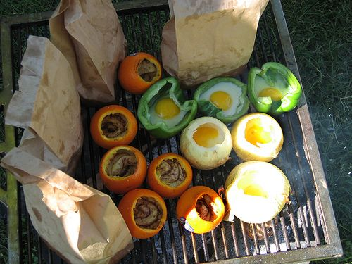 Campfire Cooking Class 1, via Flickr.  What a fabulous idea! I am so doing this. can cinnamon rolls are cooked in the oranges!