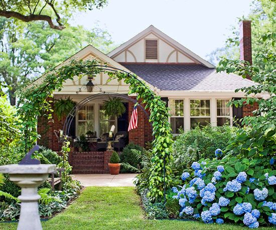 Adding an arbor creates a welcoming and inviting entryway. More curb appeal: www.bhg.com/...