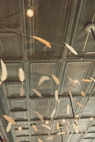 paper feathers strung amongst bistro lights
