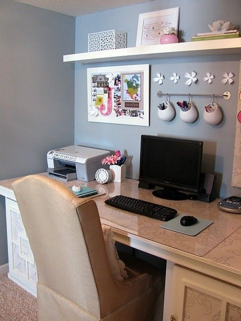 Simple, clean office space. Decor could work in a cubicle, too.