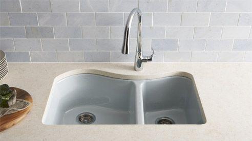 Understated light blue back-splash and sink.