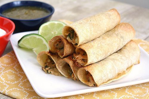 Creamy Baked Chicken Taquitos by traceysculinaryadventures: Make ahead and freeze for an easy go to weekday dinner. #Chicken #Chicken_Taquitos #Mexican
