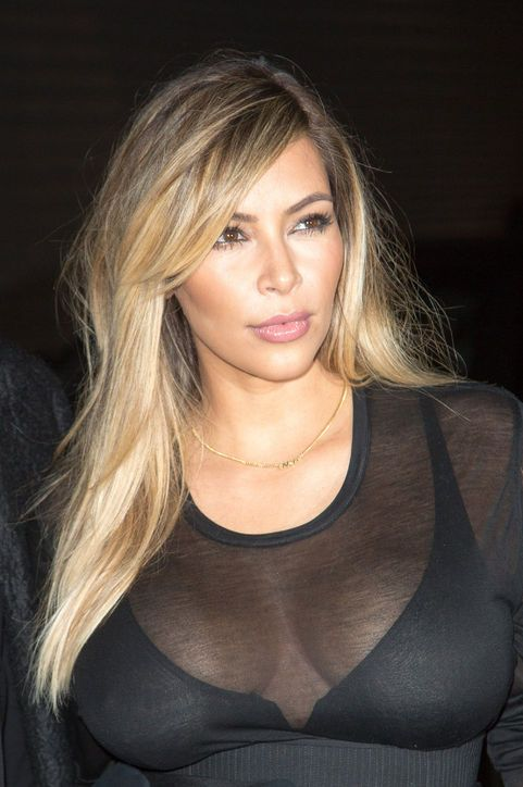kim-kardashian-blond-hair-color-paris-fashion-week  And Kim Kardashian finally took the blond hair color we know she's had for weeks now out for a spin at an official event (the Givenchy show in Paris