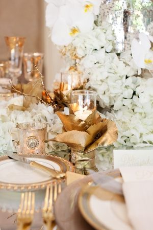 Gold paper wrapped vase | photography by www.perezweddings.com/