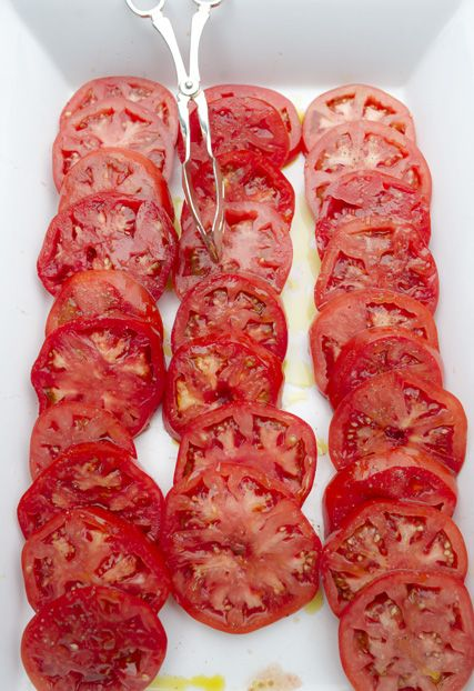 Fresh tomatoes dressed with olive oil and sea salt.
